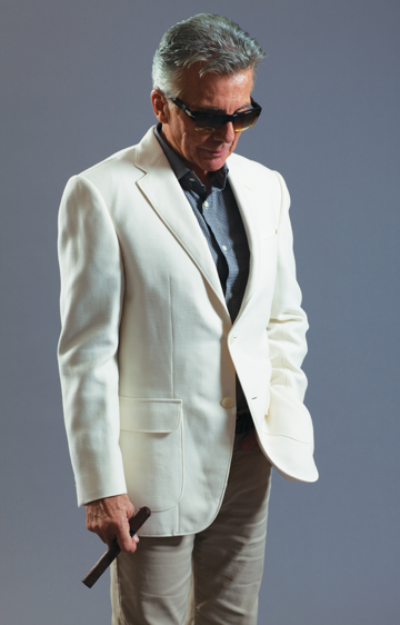 John Walsh looking cool with sunglasses and a white jacket