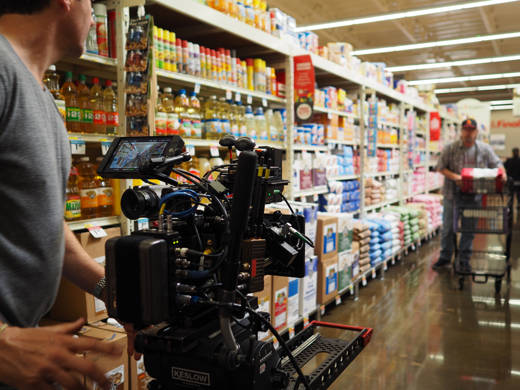 "Behind the scenes of ""What's your Smart & Final?"": Davis Elen cameraman films a shopper"