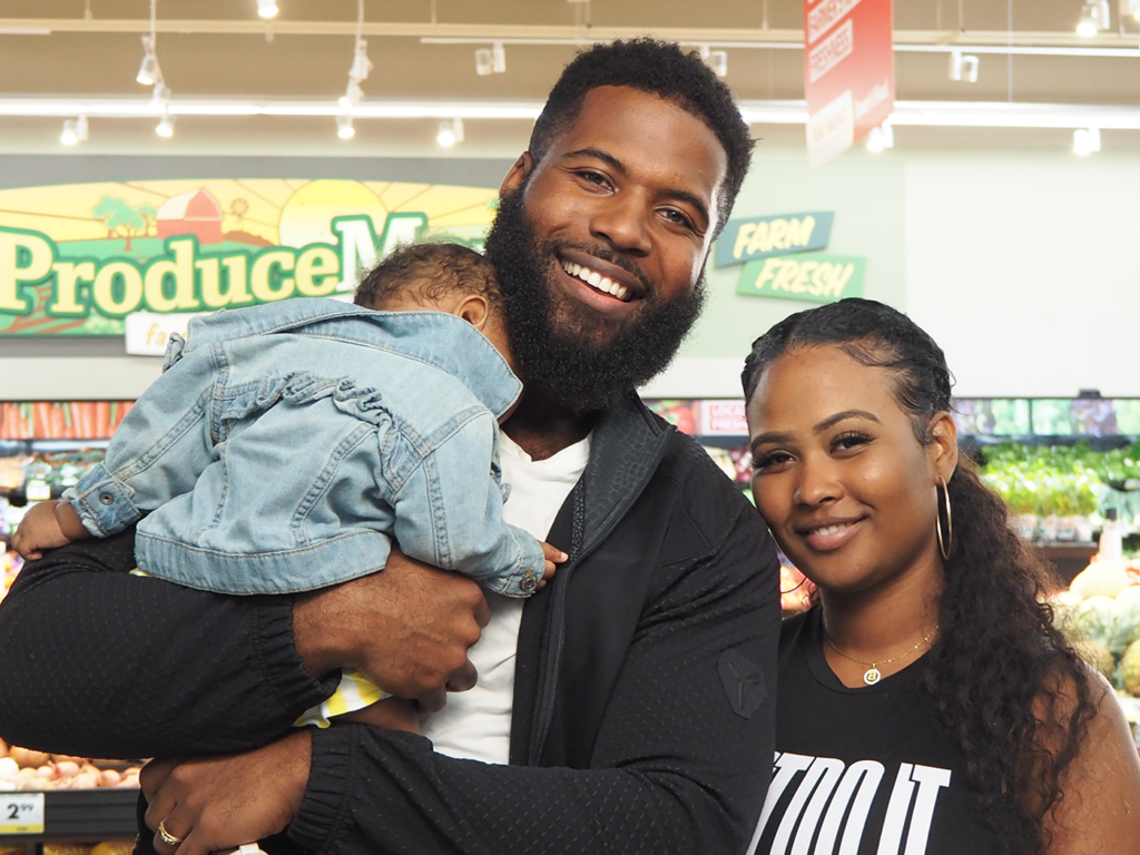 A family of three: father, mother and newborn baby, shop at Smart & Final